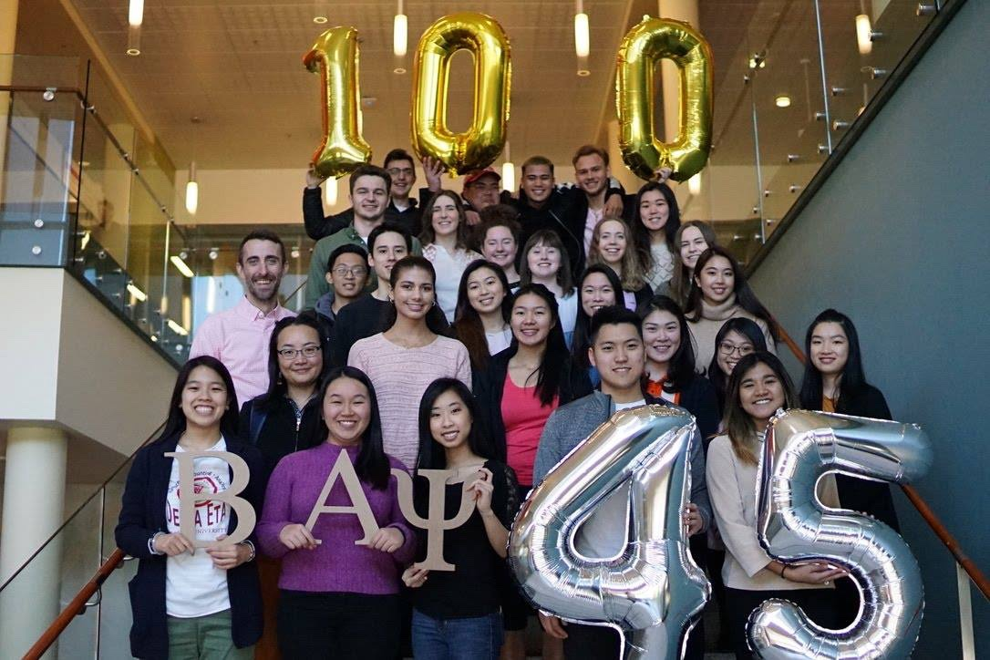 Beta Alpha Psi students celebrating 100 years since the founding of Beta Alpha Psi and 45 years since founding of the Delta Eta chapter.