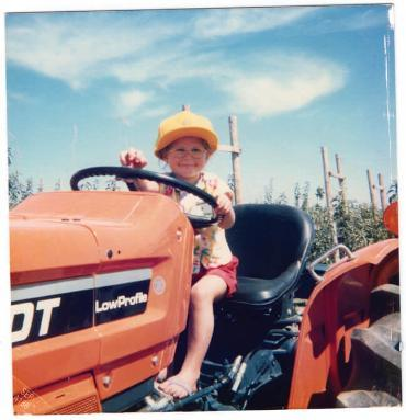 PMBA student Julia Bringolf as a child on the family tractor