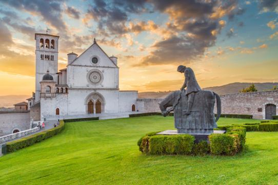 a shutterstock photo of a statue of St Francis on a horse in front of a church