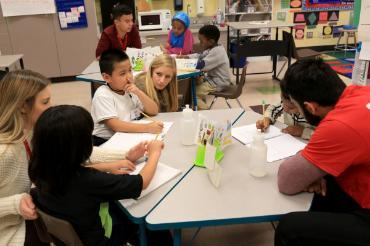 one on one mentors and mentees sit down together at a table at bailey gatzert elementary school