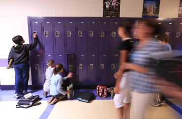 students blurry in front of lockers at washignton middle school