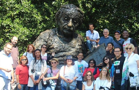 SUSI scholars pose with a statue of Alfred Einstein at the Einstein National Academy of Science