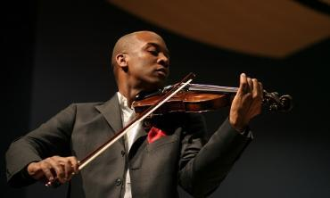 Dr. Quinton Morris, performing on the violin