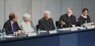 Father Pat Kelly speaks at a press conference