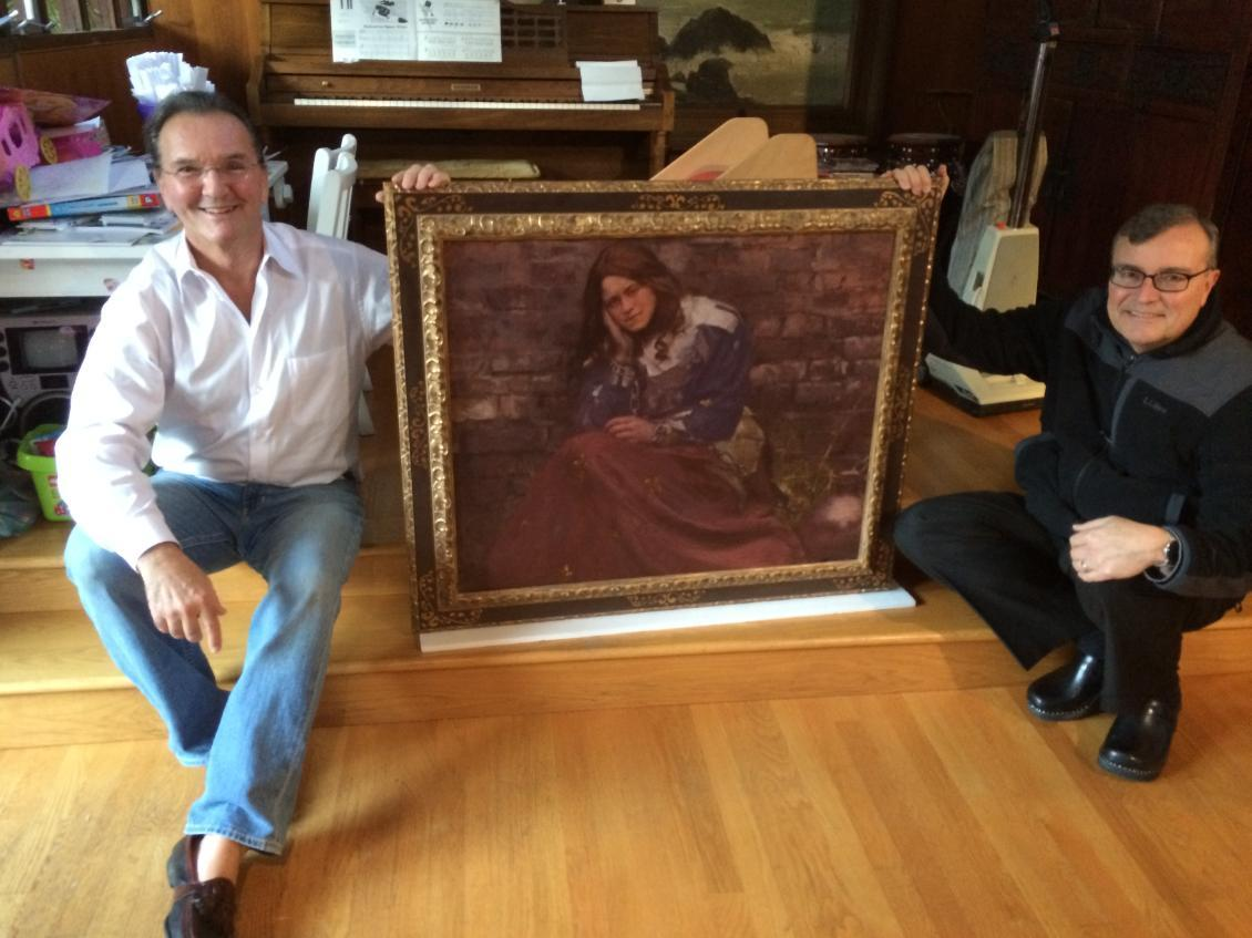 Artist Paul Mullally and Father Bill Watson pose with Paul's painting of Thérèse of Lisieux