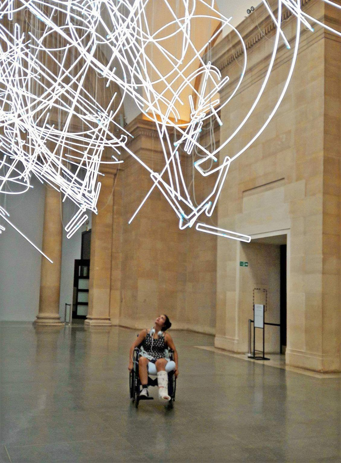Photo of woman in wheelchair viewing art in the Tate Britain by Mary-Antoinette Smith, PhD
