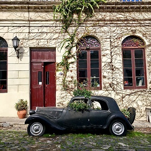 Photo of car in front of building by Theresa (Tess) Honan; ; Wandering the Streets of Colonia del Sacramento (Colonia del Sacramento, Uruguay)
