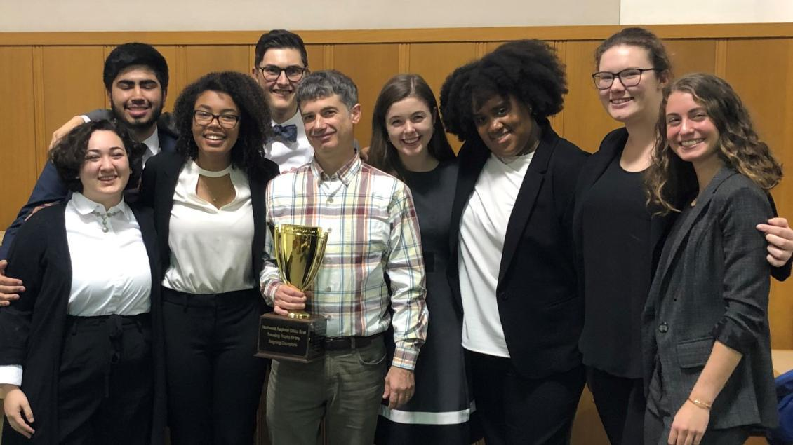 Students and coach of the Ethics Bowl Team