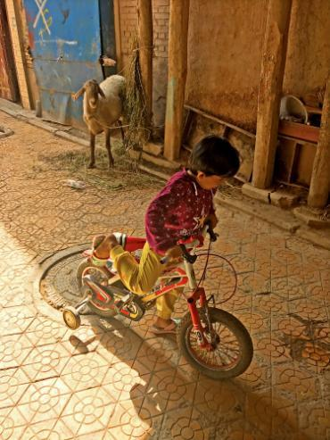 Child riding a bike in China