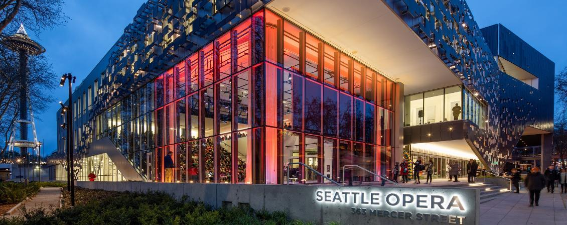 Photo of Seattle Opera building with red lighting