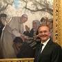 Alum Paul Mullally posing with his portrait of Pope Francis