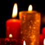 Red and gold candles on black background