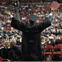 Graduate celebrates with crowd at commencement