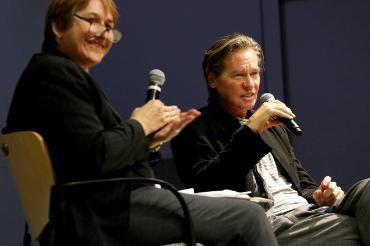 Dr. Kirsten Thompson interviews esteemed actor Val Kilmer at a campus Q&A event.