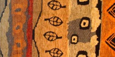 Image of African fabric in reds, browns, and oranges