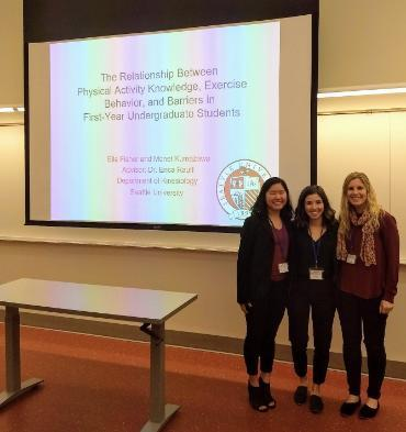 Two students and professor Erica Rauff after presenting at a conference