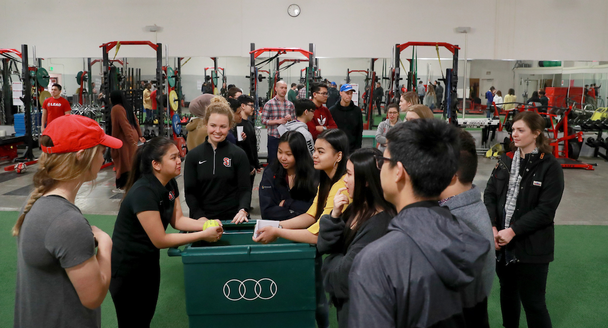 Students talk during demonstration at 2019 Kinesiology Biomechanics Fair