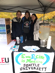 3 students from Exercise Is Medicine club volunteering at Seattle U 5K event