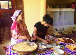 Two people cooking food in Morocco