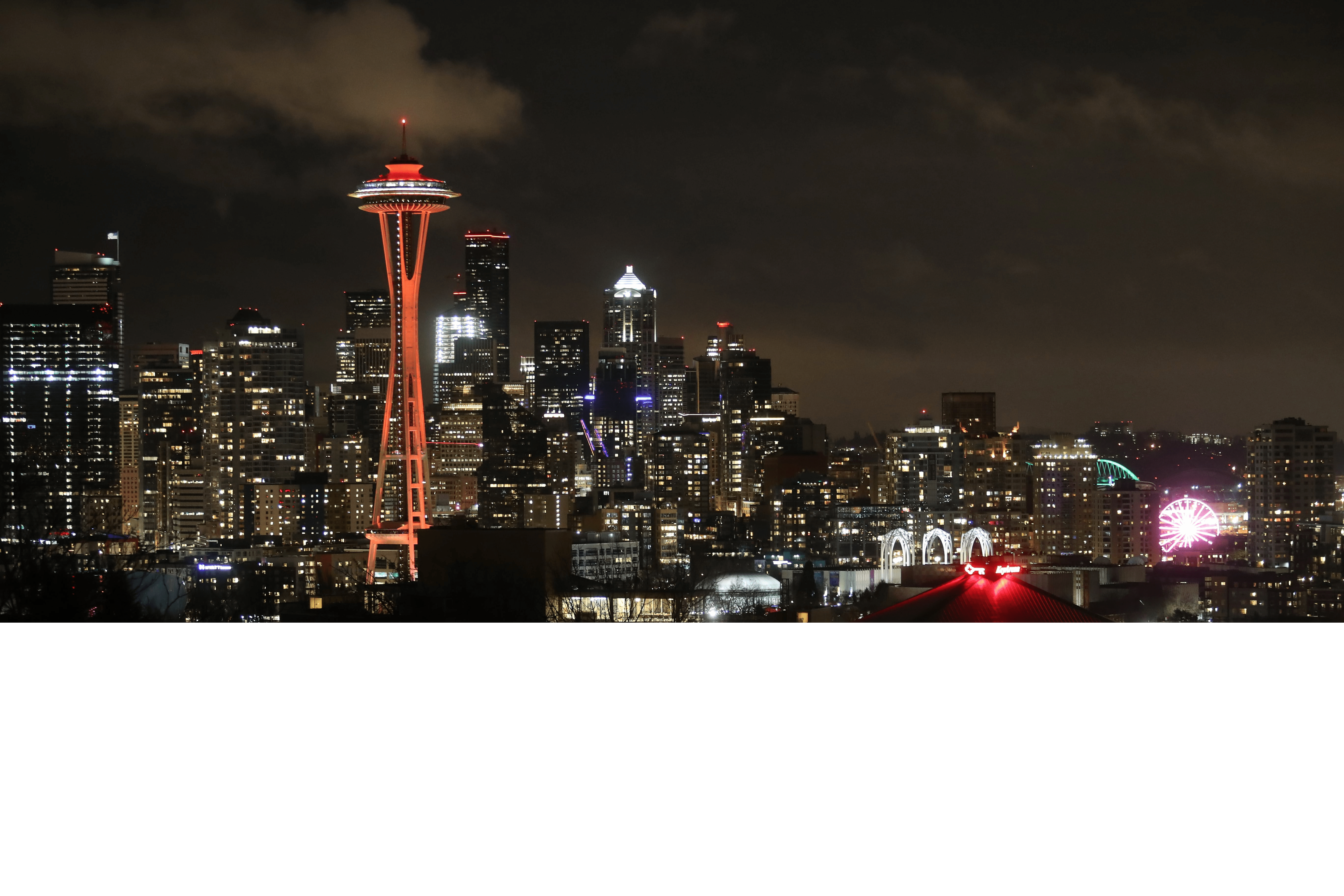 Seattle Skyline lit up in red