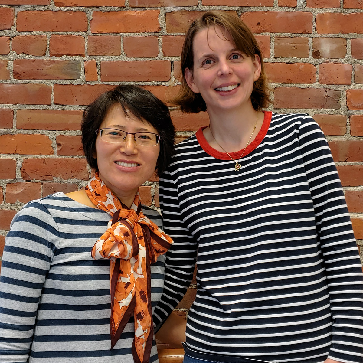 Two nursing faculty members named Mo Sin and Alise Owens are standing beside each other