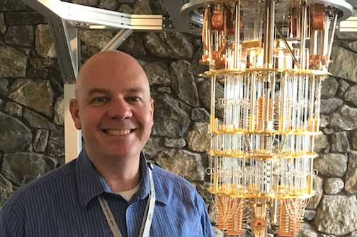Brian Eccles of IBM standing in front of the Quantum Computer