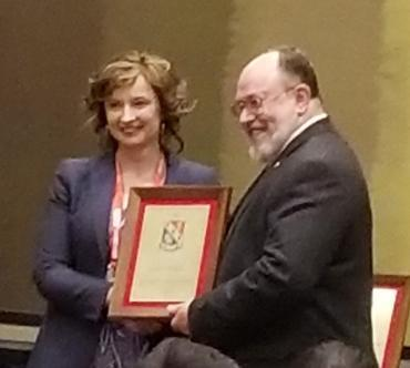 Agnieszka Miguel receiving HKN Chapter award at the ECEDHA Conference
