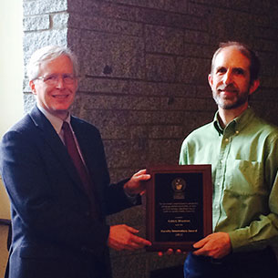 Dean Quinn awards Dr. Mason the Faculty Innovation Award