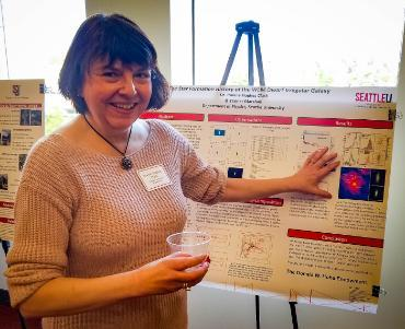 Joanne Hughes at the Fall Faculty Research event sharing her poster.
