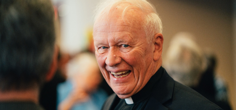 Fr. Pat Howell Smiling in Collar