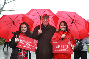 Father Steve at the Homecoming Red Umbrella Parade