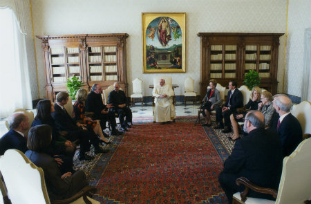 Father Steve with a group meeting and speaking with Pope Francis