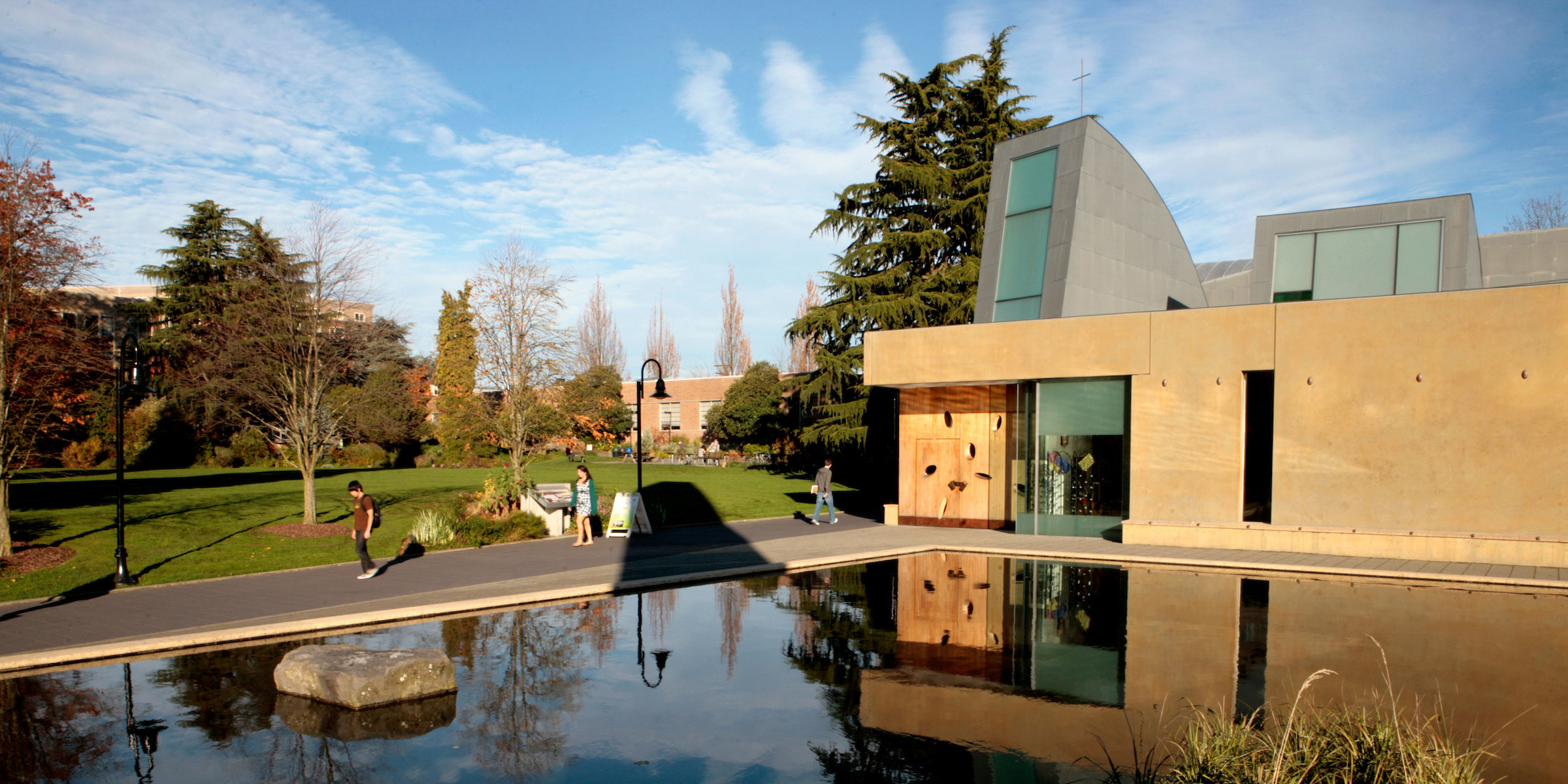 view of campus chapel, reflecting pool, and Union Green on a sunny fall morning