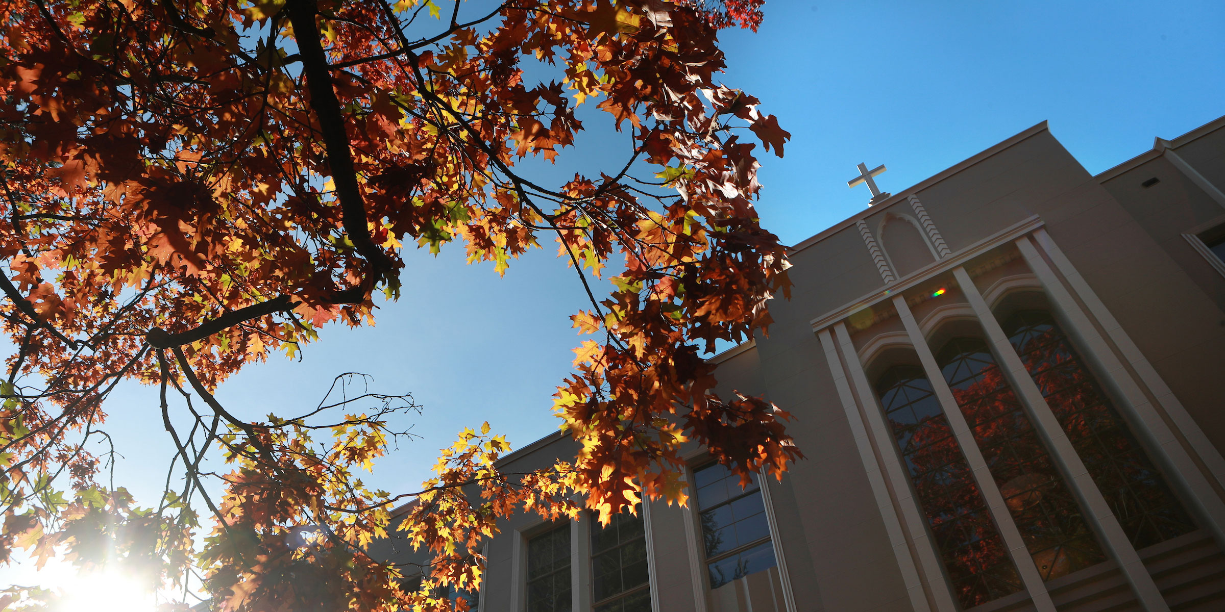 looking upwards at the entrance to the Administration building and colorful fall trees