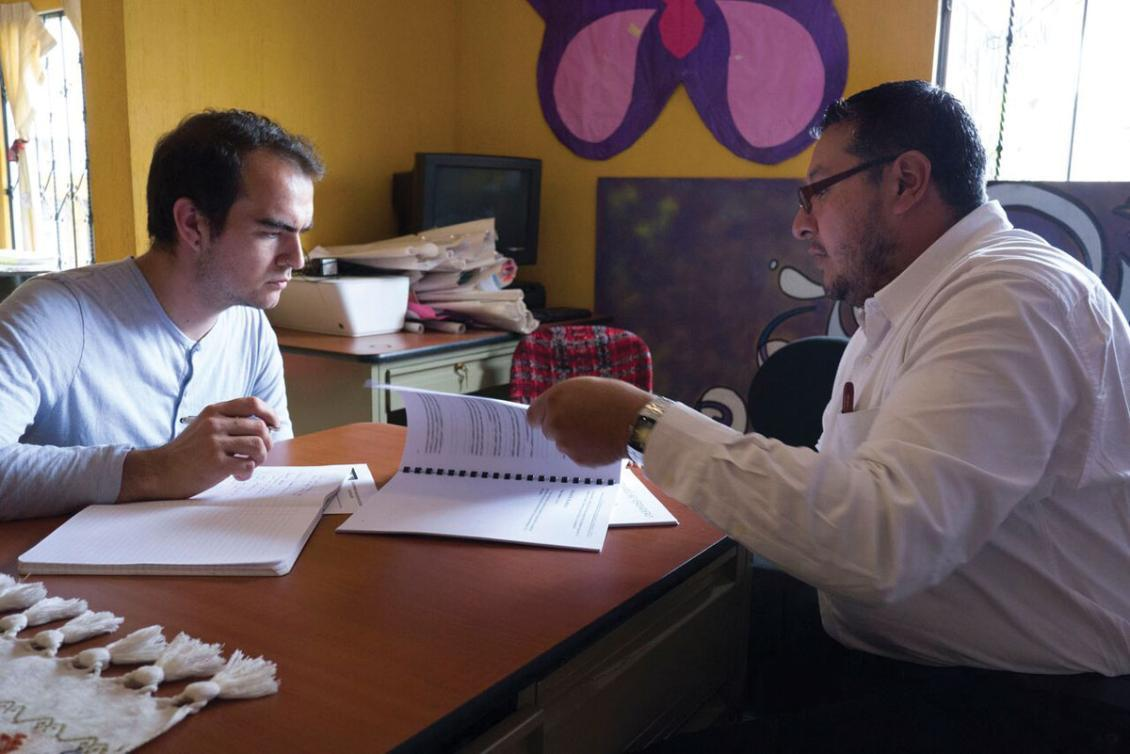 Michael Lott, '16 (left) meets with a project colleague while conducting research in Guatemala.