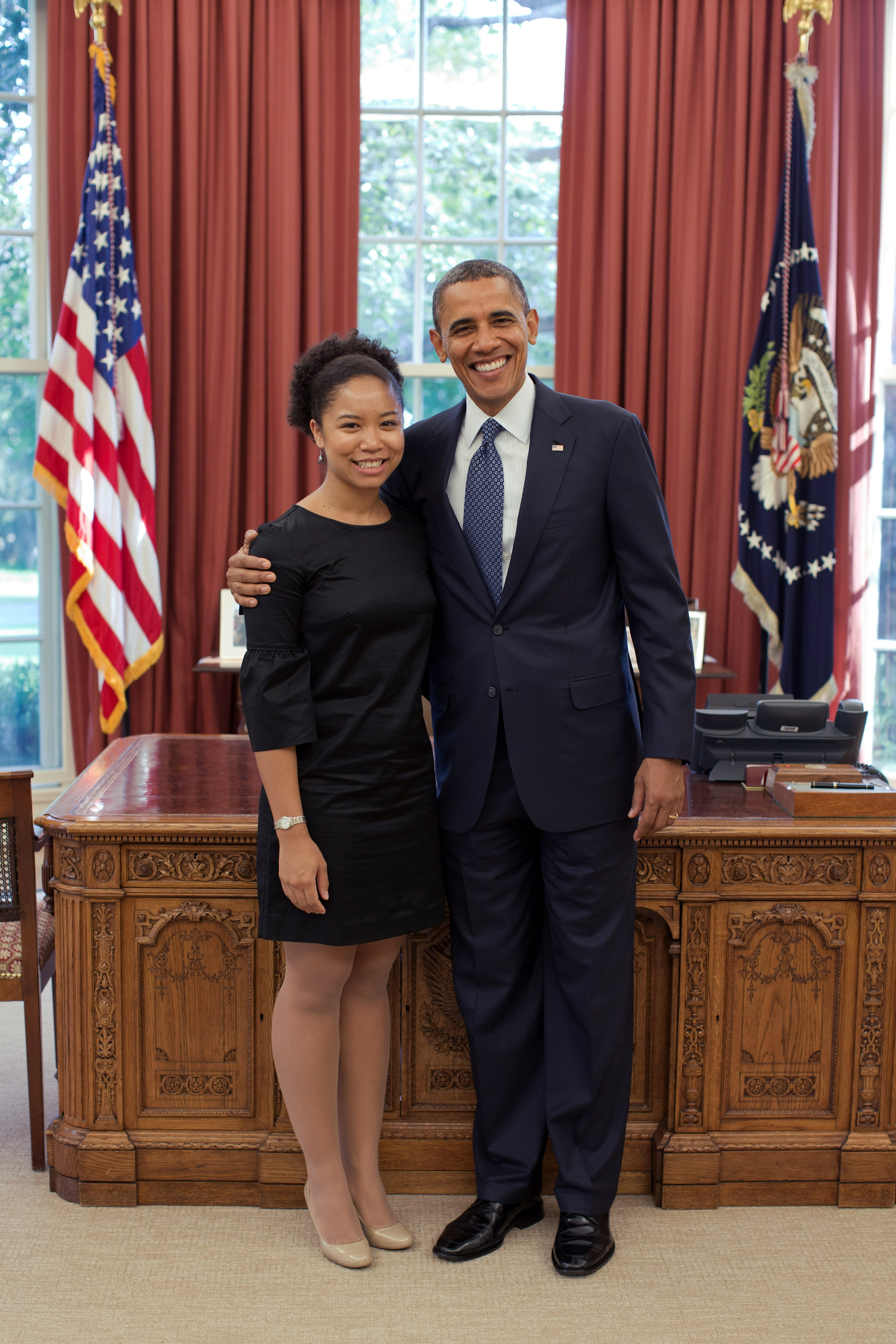 Student, Aerica Banks, recipient of Truman, PPIA, Udall, and (unknown) fellowships pictured with former United States president, Barack Obama, in the oval office