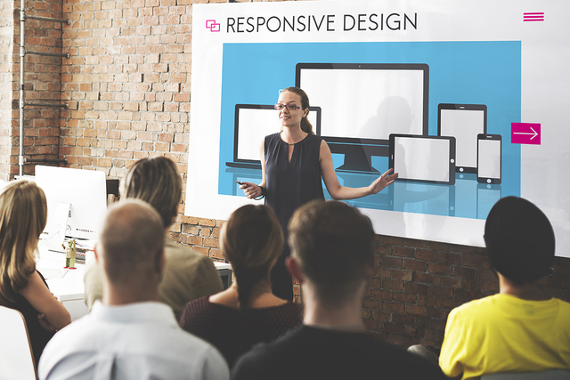 Lecture to Students in front of a Responsive Design Banner