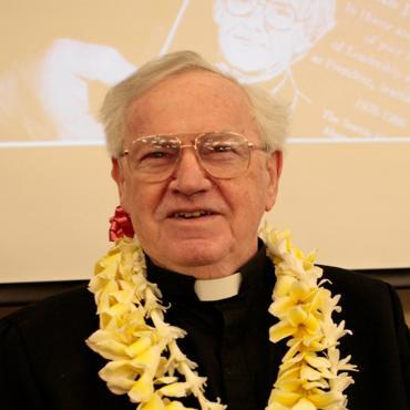 Fr Sullivan wearing a Hawaiian lei in 2012 at his campus Goodbye Party