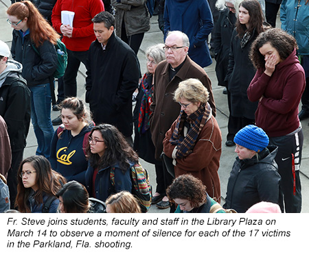 Father Steve joins students, faculty, and staff in the Library Plaza on March 14 to observe a moment of silence for each of the 17 victims in the Parkland, FL shooting