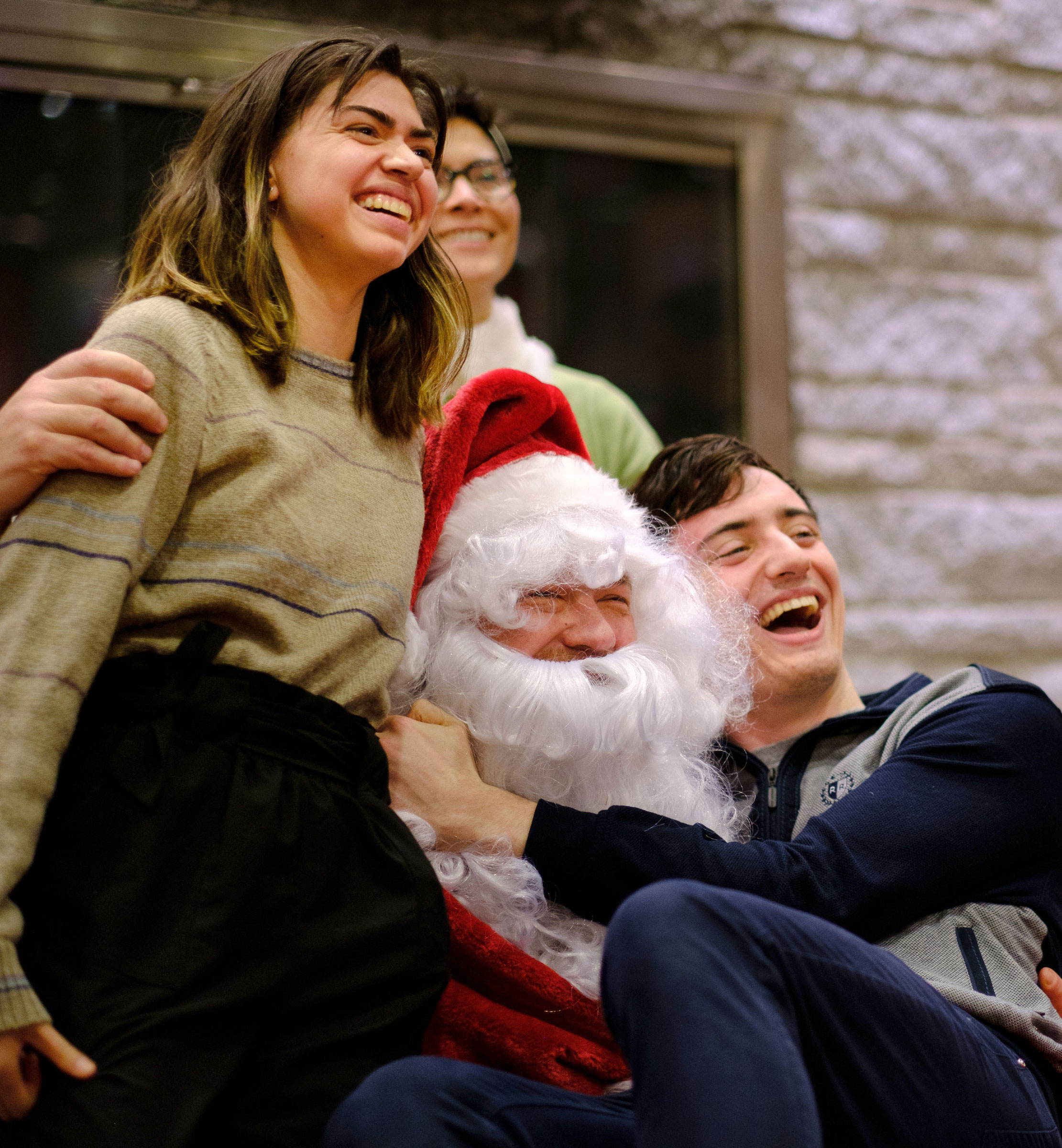 students pose for a portrait with Santa