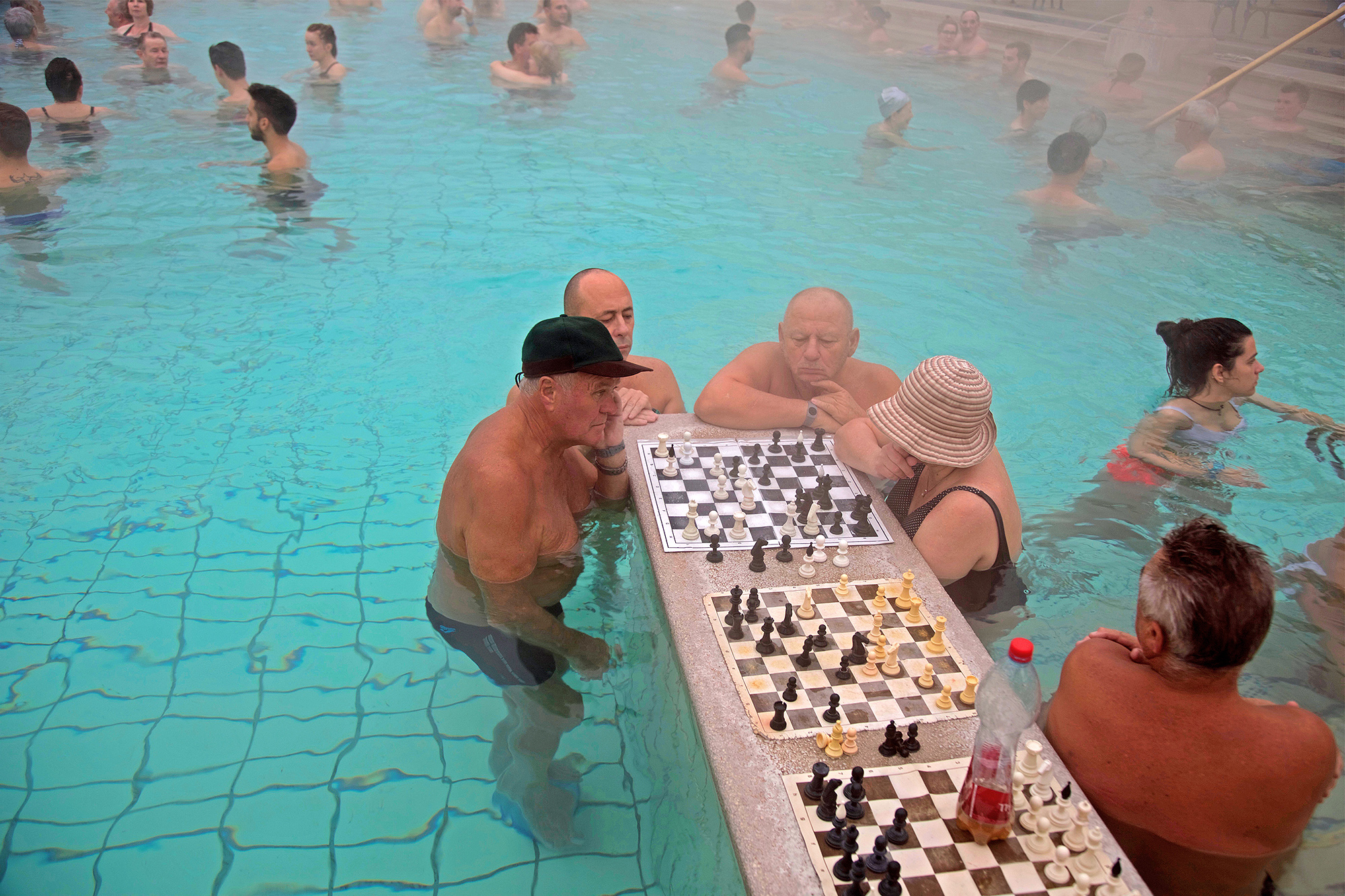 bathers play chess in the thermal baths of Budapest