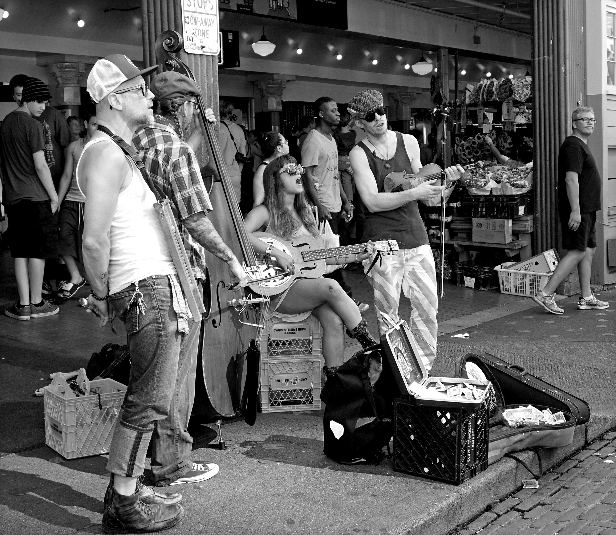 black and white photo of buskers at the Pike Place Market