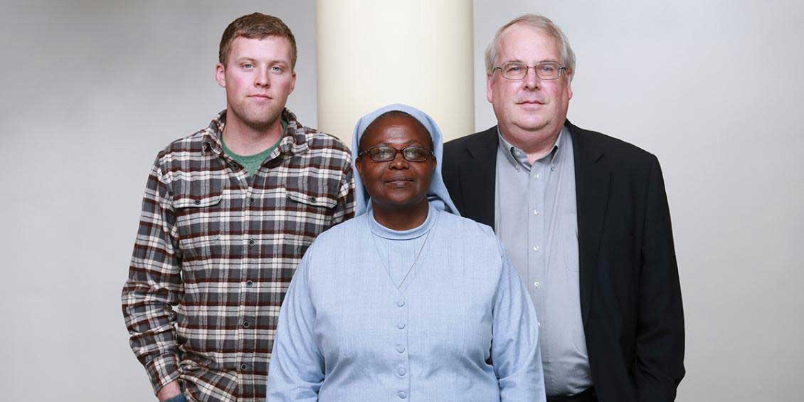 Pictured l-r: Andrew McAferty, '16, Sister Elizabeth Namazzi and Jim Dooley, '76